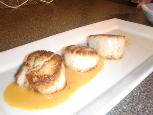 Seared Sea Scallops Over Saffron Orange Reduction